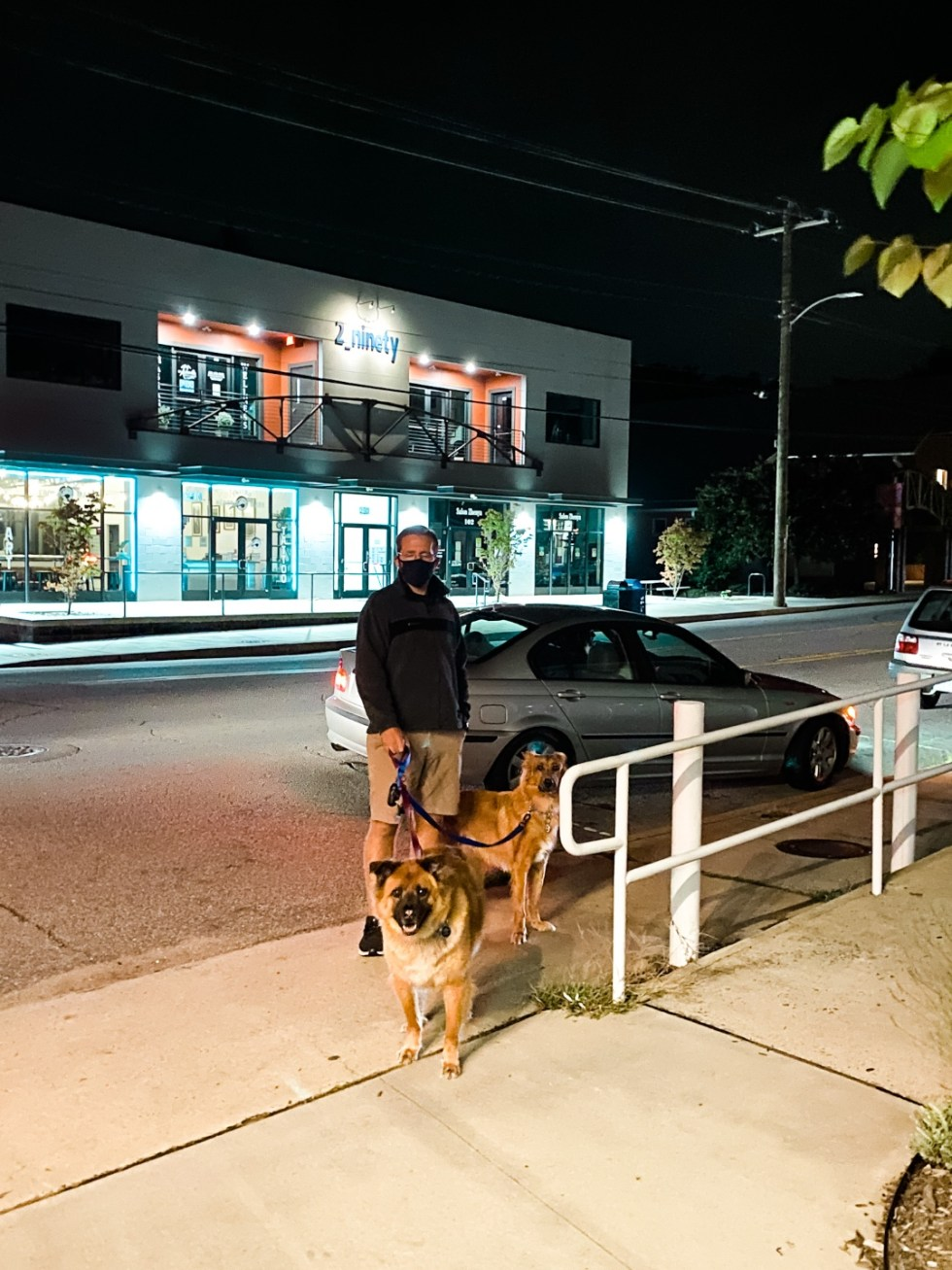 A Casual Weekend in Asheville: the Best Things to Do with your Dogs - I'm Fixin' To - @mbg0112   Weekend In Asheville by popular NC travel blog, I'm Fixin' To: image of a man and his two dogs standing outside.