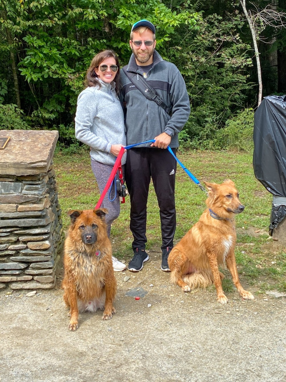 A Casual Weekend in Asheville: the Best Things to Do with your Dogs - I'm Fixin' To - @mbg0112   Weekend In Asheville by popular NC travel blog, I'm Fixin' To: image of a man and woman standing together outside with their dogs.