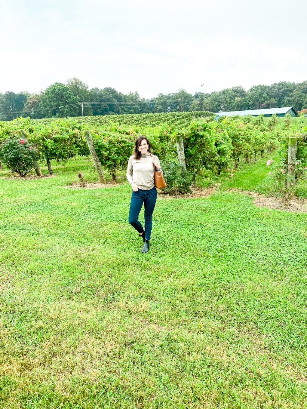 Western NC Wineries: 6 Wineries to Visit During your Next Girls' Weekend - I'm Fixin' To - @mbg0112 |Western NC Wineries by popular NC blog, I'm Fixin' To: image of a woman standing outside at Shelton Vineyards.