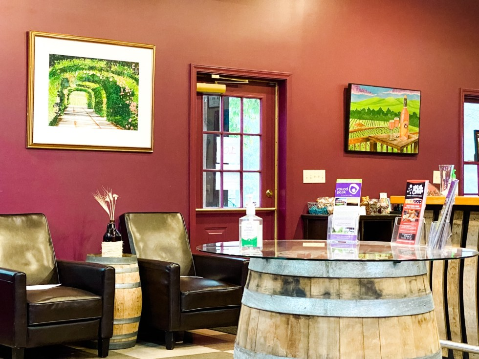 Western NC Wineries: 6 Wineries to Visit During your Next Girls' Weekend - I'm Fixin' To - @mbg0112 |Western NC Wineries by popular NC blog, I'm Fixin' To: image of a wine tasting room at Round Peak Vineyards.