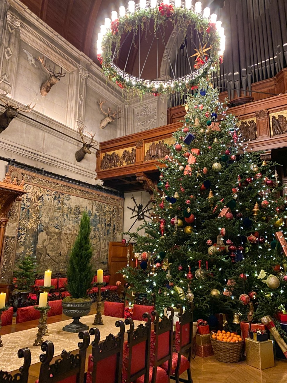 Christmas in Asheville NC by popular NC lifestyle blog, I'm Fixin' To: image of dining room with organ pipes and a large Christmas tree at the Biltmore House.