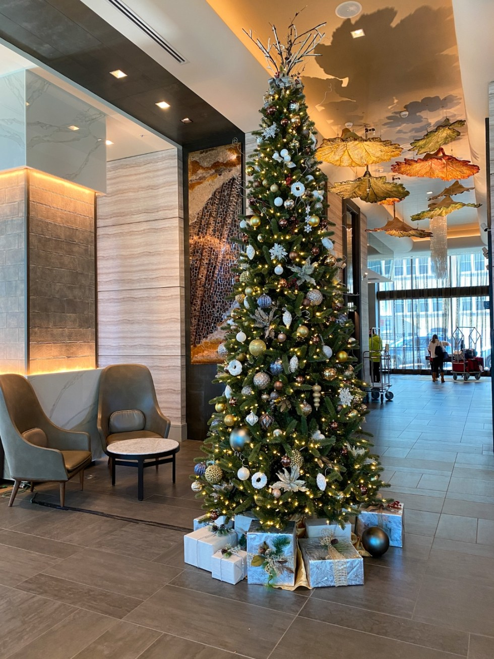 Christmas in Asheville: a Weekend Getaway During the Holidays - I'm Fixin' To - @imfixintoblog |Christmas in Asheville NC by popular NC lifestyle blog, I'm Fixin' To: image of a Christmas tree in the Kimpton hotel lobby.