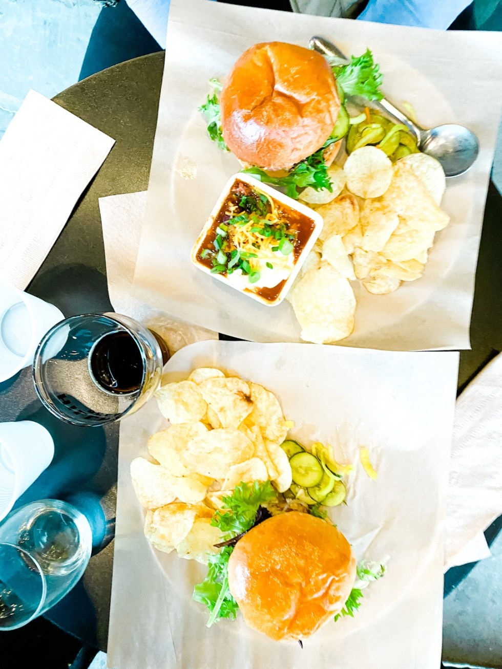Christmas in Asheville: a Weekend Getaway During the Holidays - I'm Fixin' To - @imfixintoblog |Christmas in Asheville NC by popular NC lifestyle blog, I'm Fixin' To: image of a plate of burgers and chips at Hillman Beer.