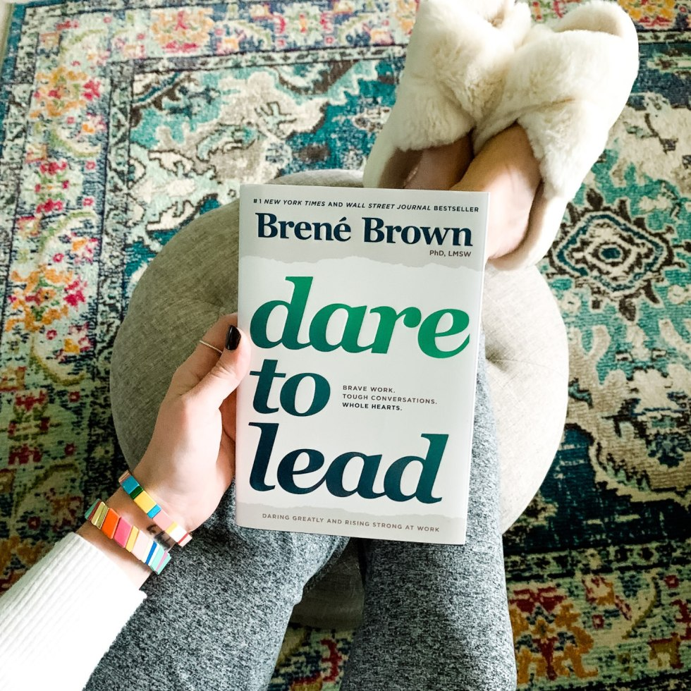 Most Popular Posts of 2020 - I'm Fixin' To - @imfixintoblog |Most Popular Posts by popular NC lifestyle blog, I'm Fixin' To: image of a woman wearing grey jogger pants, cream fuzzy slippers, and holding a Brene Brown Dare to Lead book.