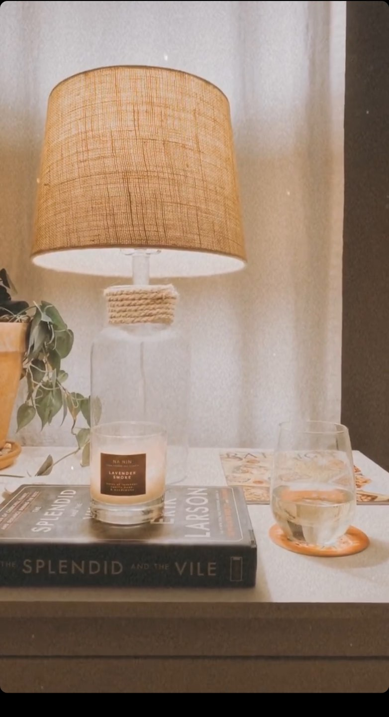 3 Years in Our Ranch: Home Updates - I'm Fixin' To - @imfixintoblog |Home Updates by popular NC life and style blog, I'm Fixin' To: image of a end table with a clear glass stand lamp, candle, and coffee table book.