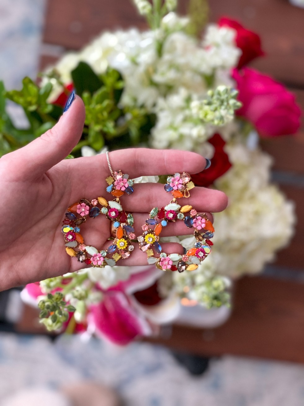 Statement Earrings that I Love - I'm Fixin' To - @imfixintoblog |Statement Earrings by popular NC fashion blog, I'm Fixin' To: image of a woman wearing a pair of J. Crew floral hoop earrings.