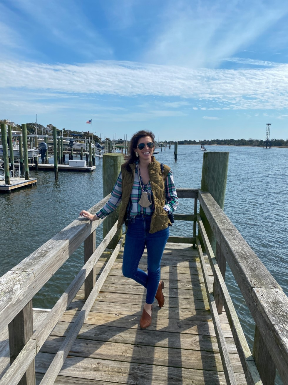 Weekend Travel: The Best Things to Do in Beaufort NC in 48 Hours - I'm Fixin' To - @imfixintoblog |Things to Do in Beaufort NC by popular NC travel blog, I'm Fixin' To: image of a woman standing on a pier.