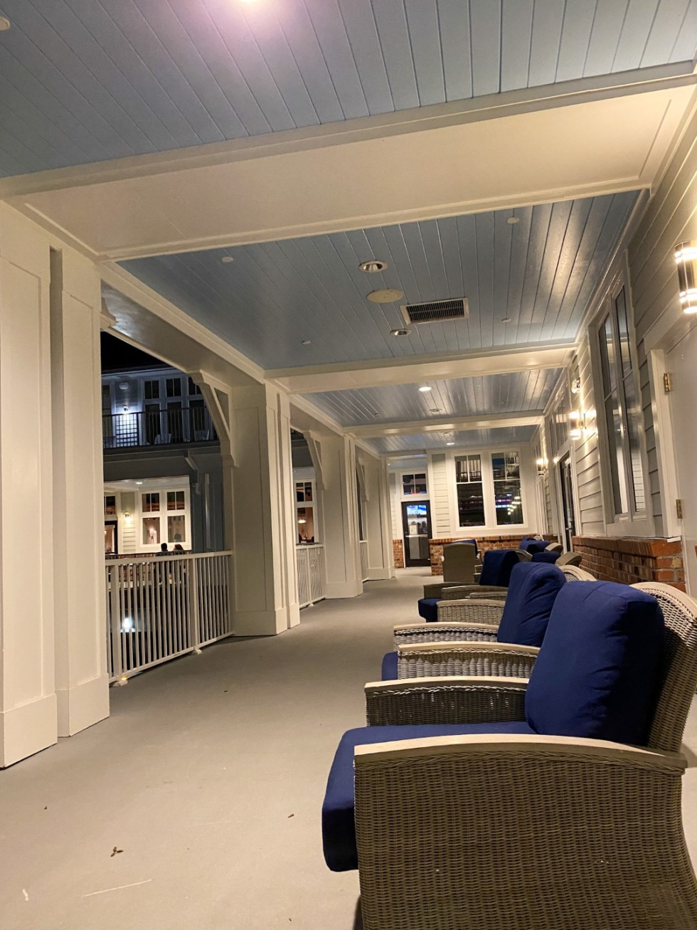 Weekend Travel: The Best Things to Do in Beaufort NC in 48 Hours - I'm Fixin' To - @imfixintoblog |Things to Do in Beaufort NC by popular NC travel blog, I'm Fixin' To: image of a covered porch with blue lounge chairs.