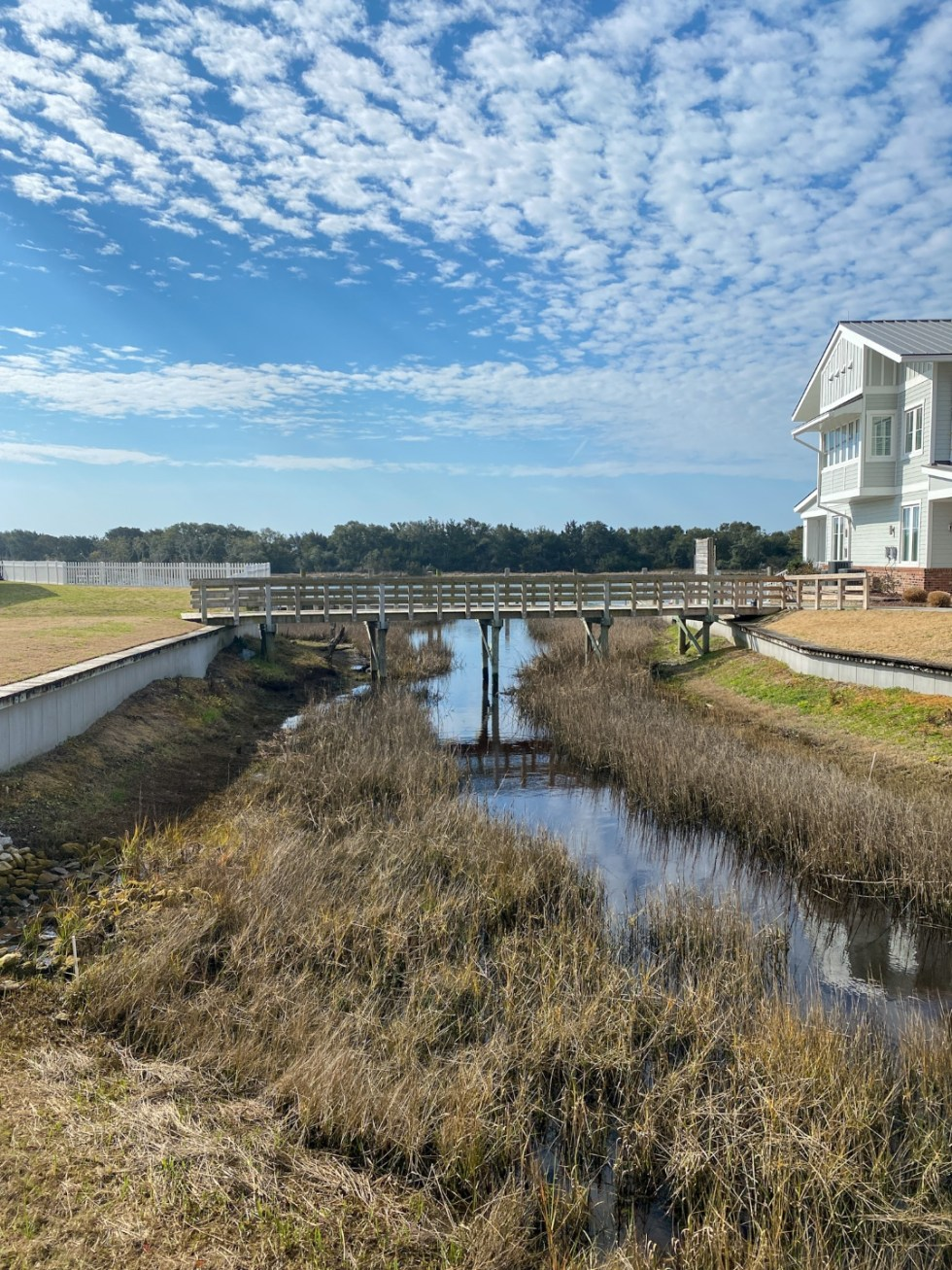 Weekend Travel: The Best Things to Do in Beaufort NC in 48 Hours - I'm Fixin' To - @imfixintoblog |Things to Do in Beaufort NC by popular NC travel blog, I'm Fixin' To: image of a wooden foot bridge.
