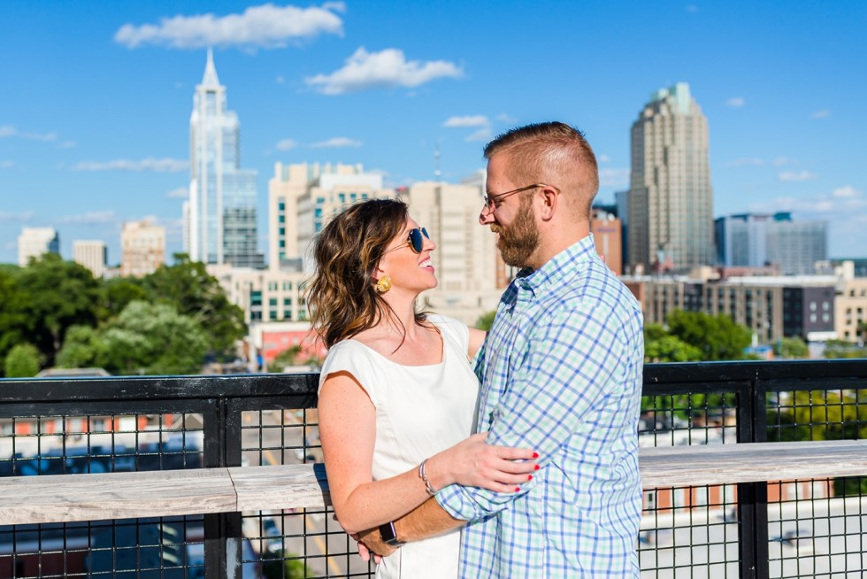 Celebrate International Women's Day with these Women Owned Businesses - I'm Fixin' To - @imfixintoblog |Women Owned Businesses by popular NC lifestyle blog, I'm Fixin' To: image of a man and woman embracing each other outside on a rooftop.