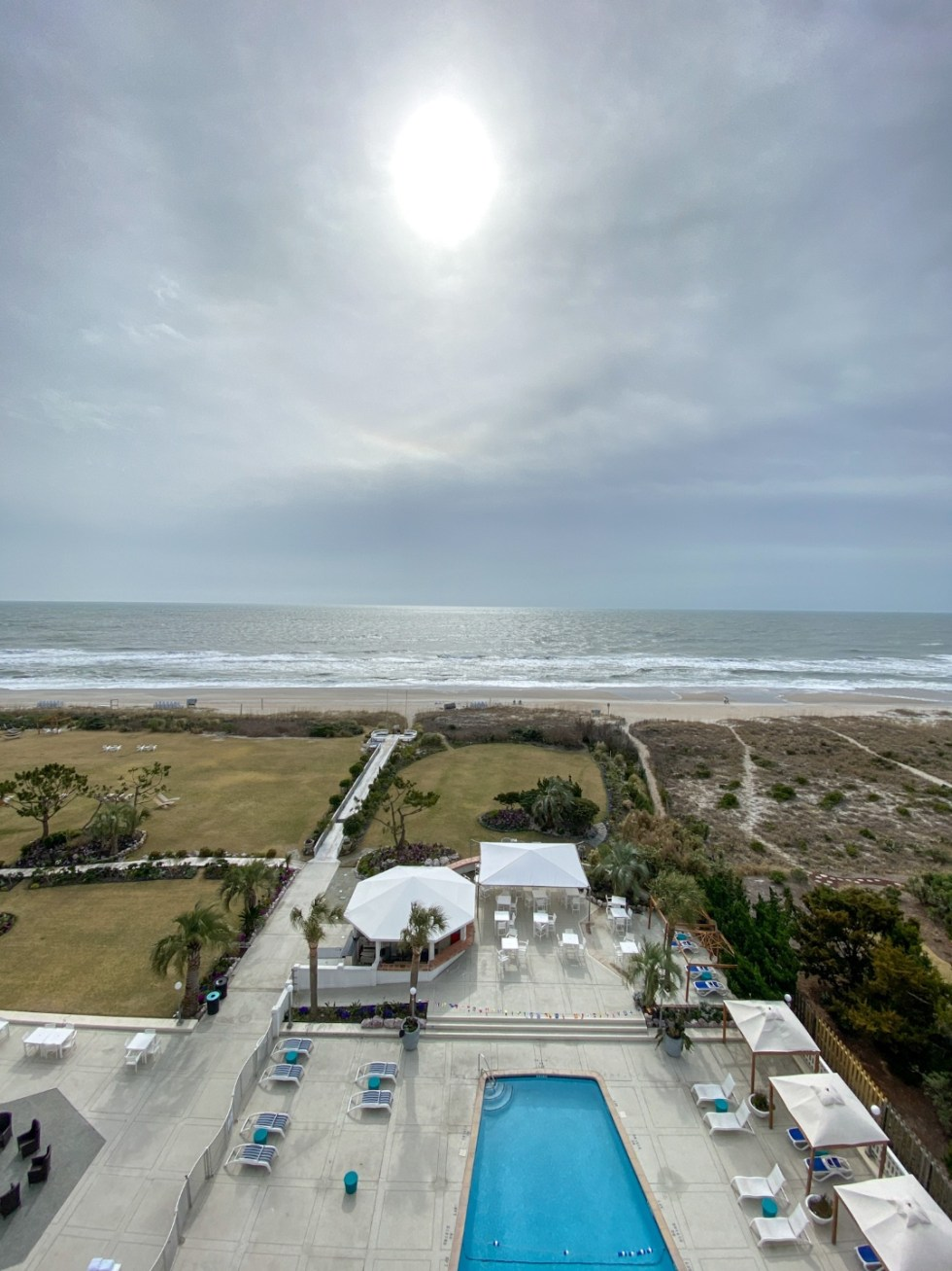 A Spring Weekend in Wilmington, NC: the Best Things to Do - I'm Fixin' To - @imfixintoblog |Weekend in Wilmington by popular NC travel blog, I'm Fixin' To: image of a outdoor swimming pool next to the beach.