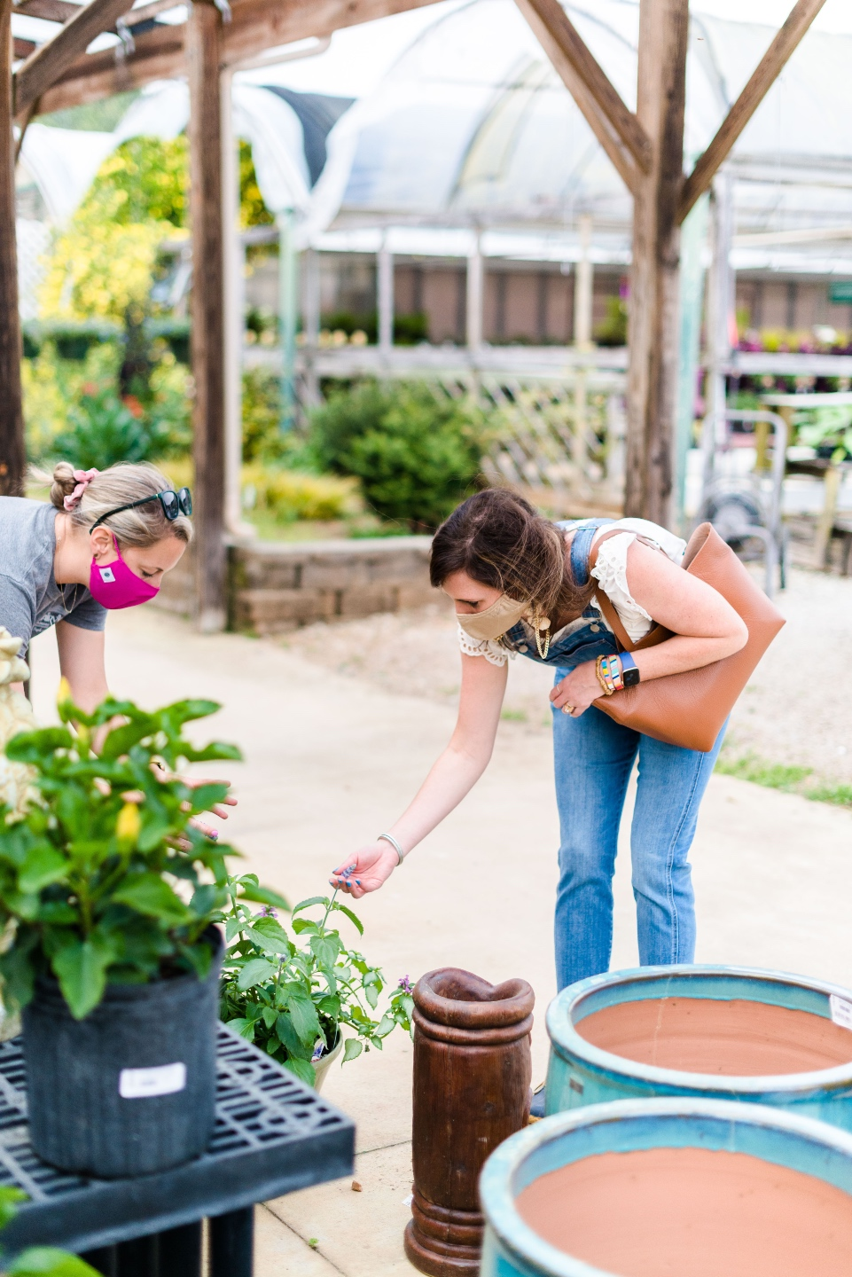 5 Spring Planting Tips with Fairview Garden Center - I'm Fixin' To - @imfixintoblog |Best Plants to Plant in Spring by popular NC lifestyle blog: image of two women looking at a plant at the Fairview Garden Center.