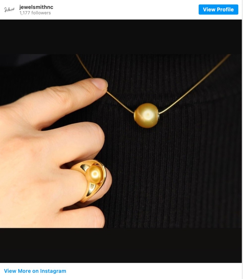 Durham Shopping: Top 11 Best Fashion Boutiques to visit After a Year of Quarantine - I'm Fixin' To - @imfixintoblog | Durham Shopping by popular NC lifestyle blog, I'm Fixin' To: image of a woman wearing a gold necklace and gold cocktail ring.