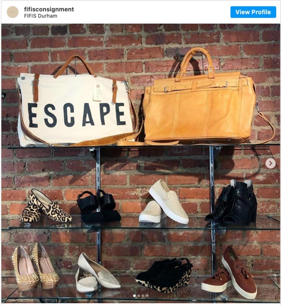 Durham Shopping: Top 11 Best Fashion Boutiques to visit After a Year of Quarantine - I'm Fixin' To - @imfixintoblog | Durham Shopping by popular NC lifestyle blog, I'm Fixin' To: image of purses and shoes on glass display shelves.