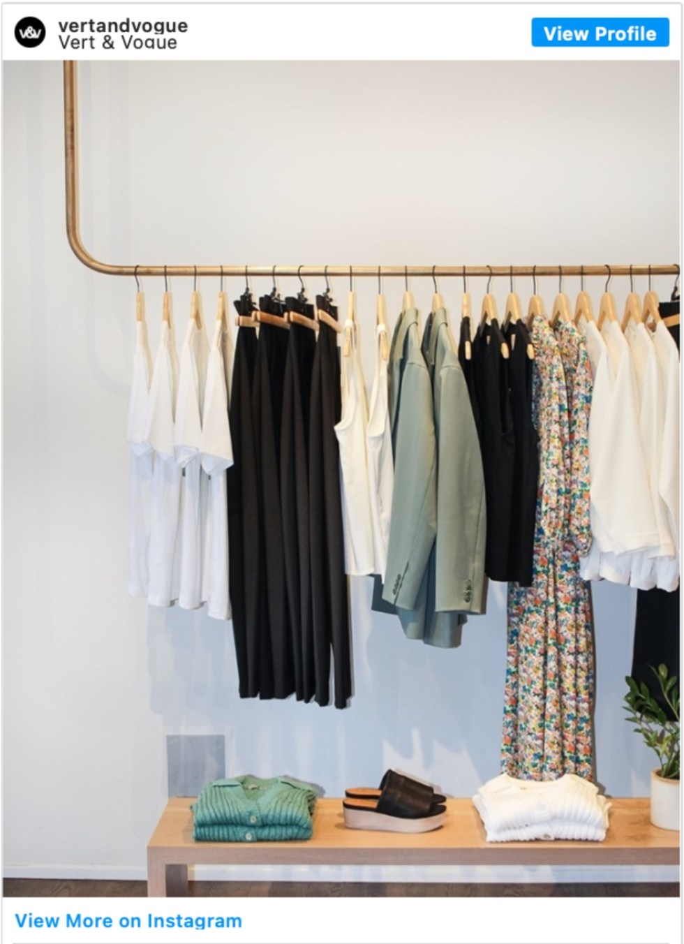 Durham Shopping: Top 11 Best Fashion Boutiques to visit After a Year of Quarantine - I'm Fixin' To - @imfixintoblog | Durham Shopping by popular NC lifestyle blog, I'm Fixin' To: image of clothes hanging on a copper bar.