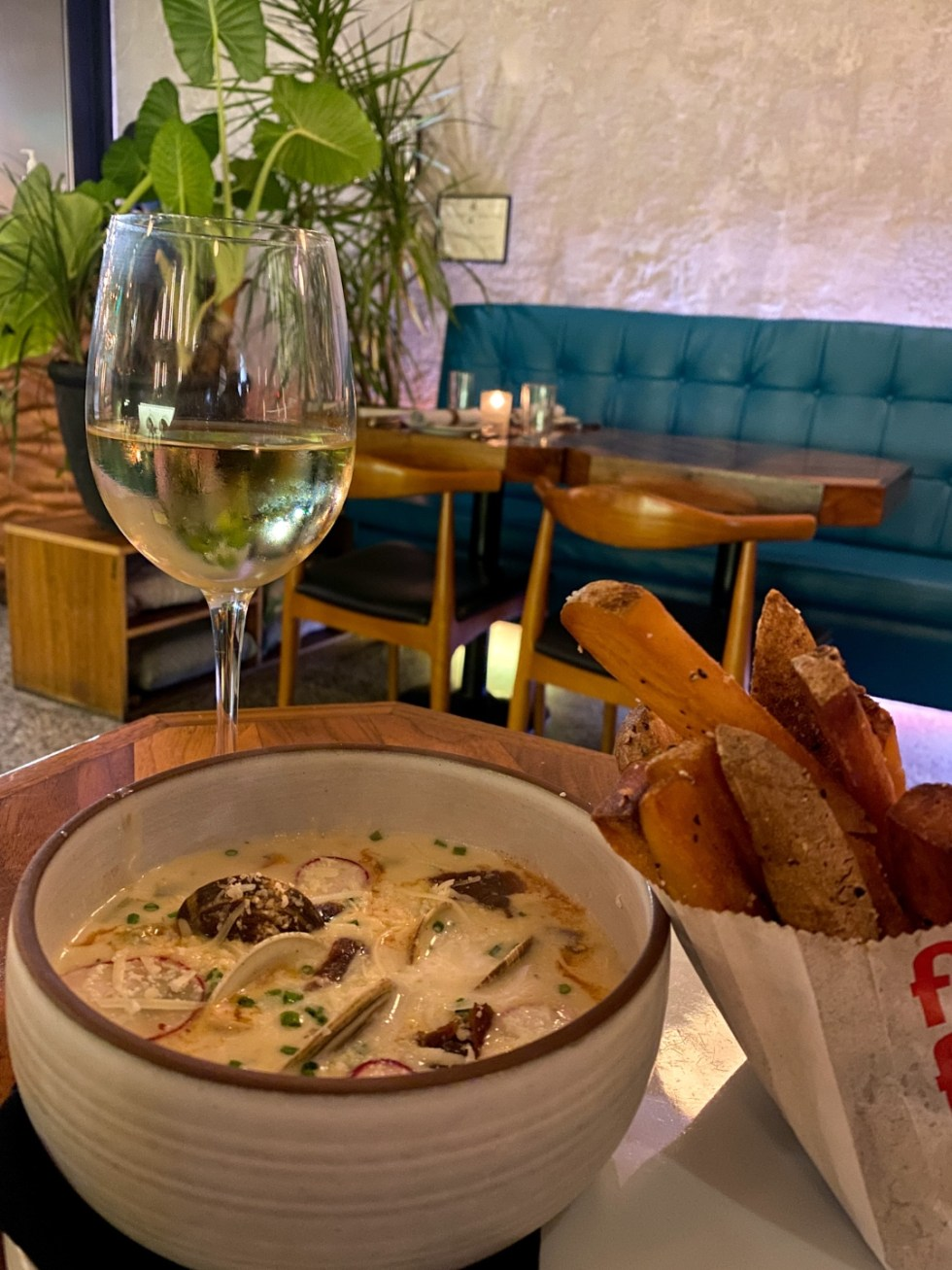 10 Iconic Dishes to Try in Raleigh - I'm Fixin' To - @imfixintoblog | Best Food in Raleigh NC by popular NC lifestyle blog, I'm Fixin' To: image of a glass of white wine, bowl of soup and bag of French fries.
