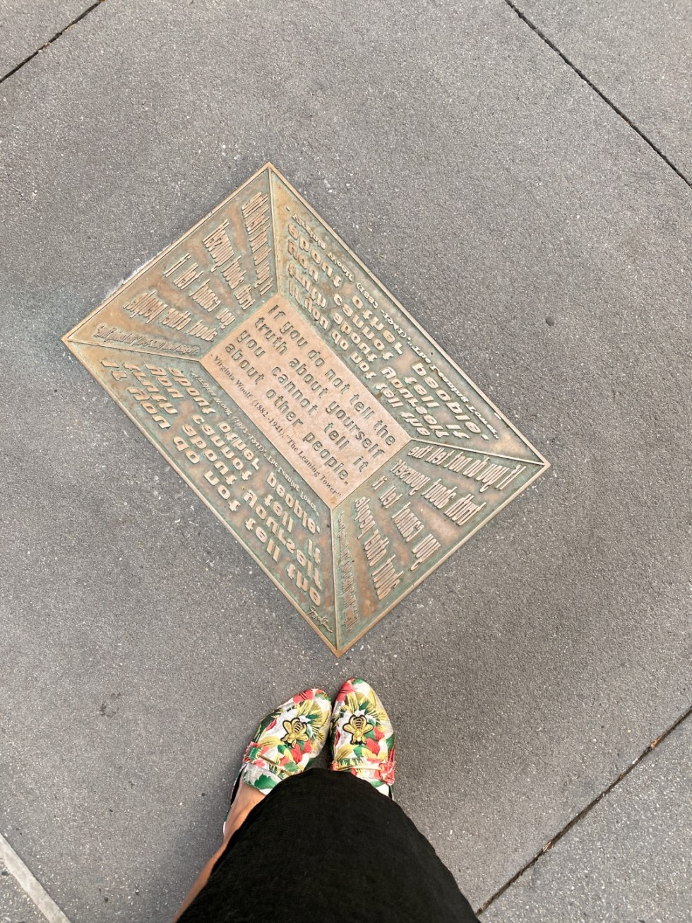 NYC Summer Weekend: Things to Do in NYC in the Summer - I'm Fixin' To - @imfixintoblog   NYC Summer Weekend by popular NC travel blog, I'm Fixin' To: image of a metal sign embedded in a sidewalk.