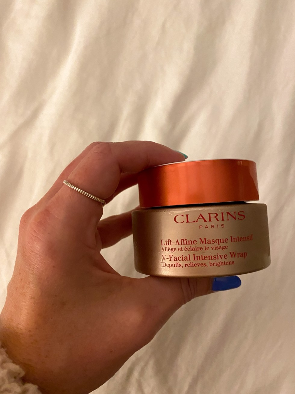 Recent Favorites: Top 10 Things I've Bought that Are Worth the Hype - I'm Fixin' To - @imfixintoblog | Recent Favorites by popular NC life and style blog, I'm Fixin' To: image of a woman holding some Clarins lift affine masque.