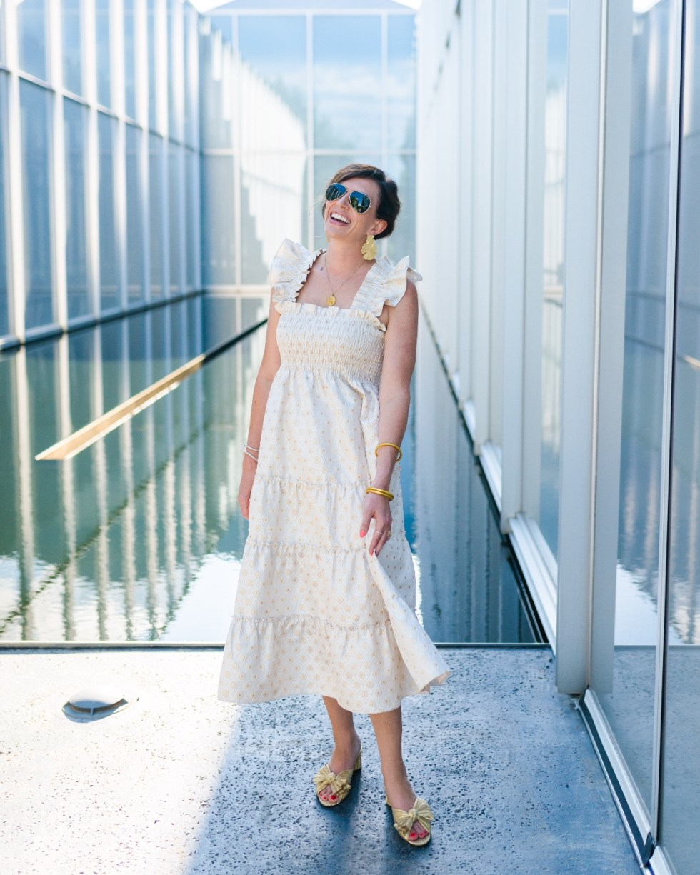Recent Favorites: Top 10 Things I've Bought that Are Worth the Hype - I'm Fixin' To - @imfixintoblog | Recent Favorites by popular NC life and style blog, I'm Fixin' To: image of a woman wearing a Hill House nap dress with gold bow shoes, gold statement earrings and aviator sunglasses.