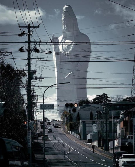 This is not a photoshop, but a 100-meter statue of the goddess Kannon located in Sendai, Japan. This is one of the tallest statues in the world.