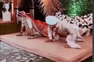 Bride And Groom Do PushUps Onstage In Viral Video