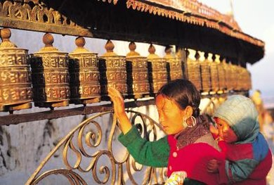 Tibetan Buddhists spin prayer wheels as a form of prayer, to accumulate merit and wisdom.