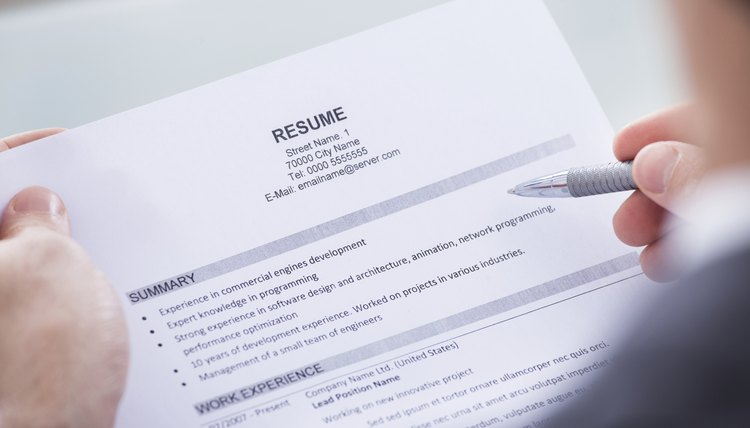 How to List Typing as a Skill on a Resume   Career Trend Businessperson Holding Resume