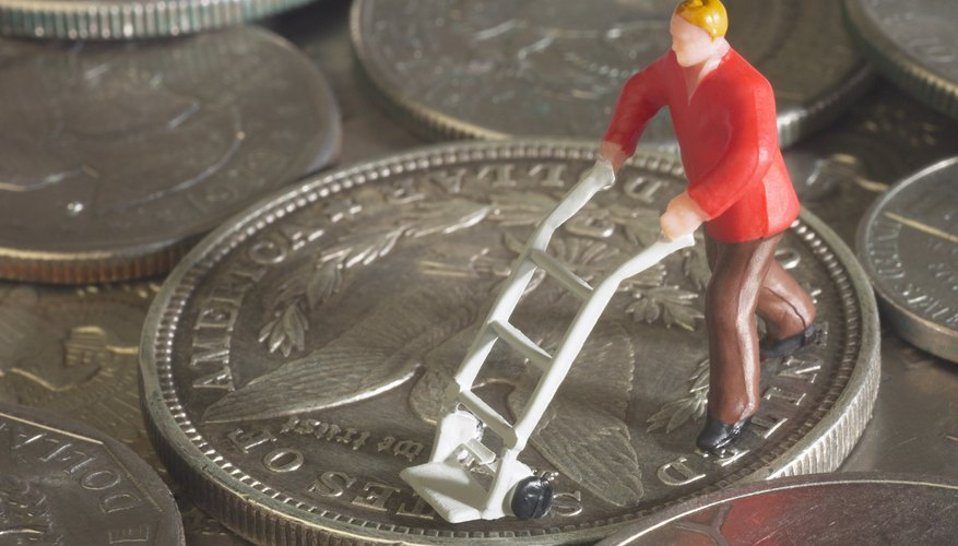 How to Convert Time for Payroll   Bizfluent Figurine with miniature hand truck on coins