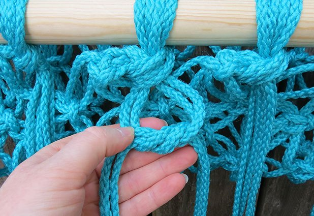 Tie a second knot to secure the cords to the frame.