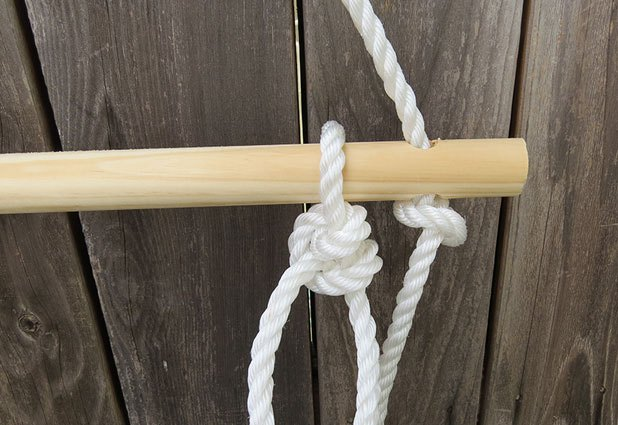 Wrap the rope around the third dowel and tie a loose knot.