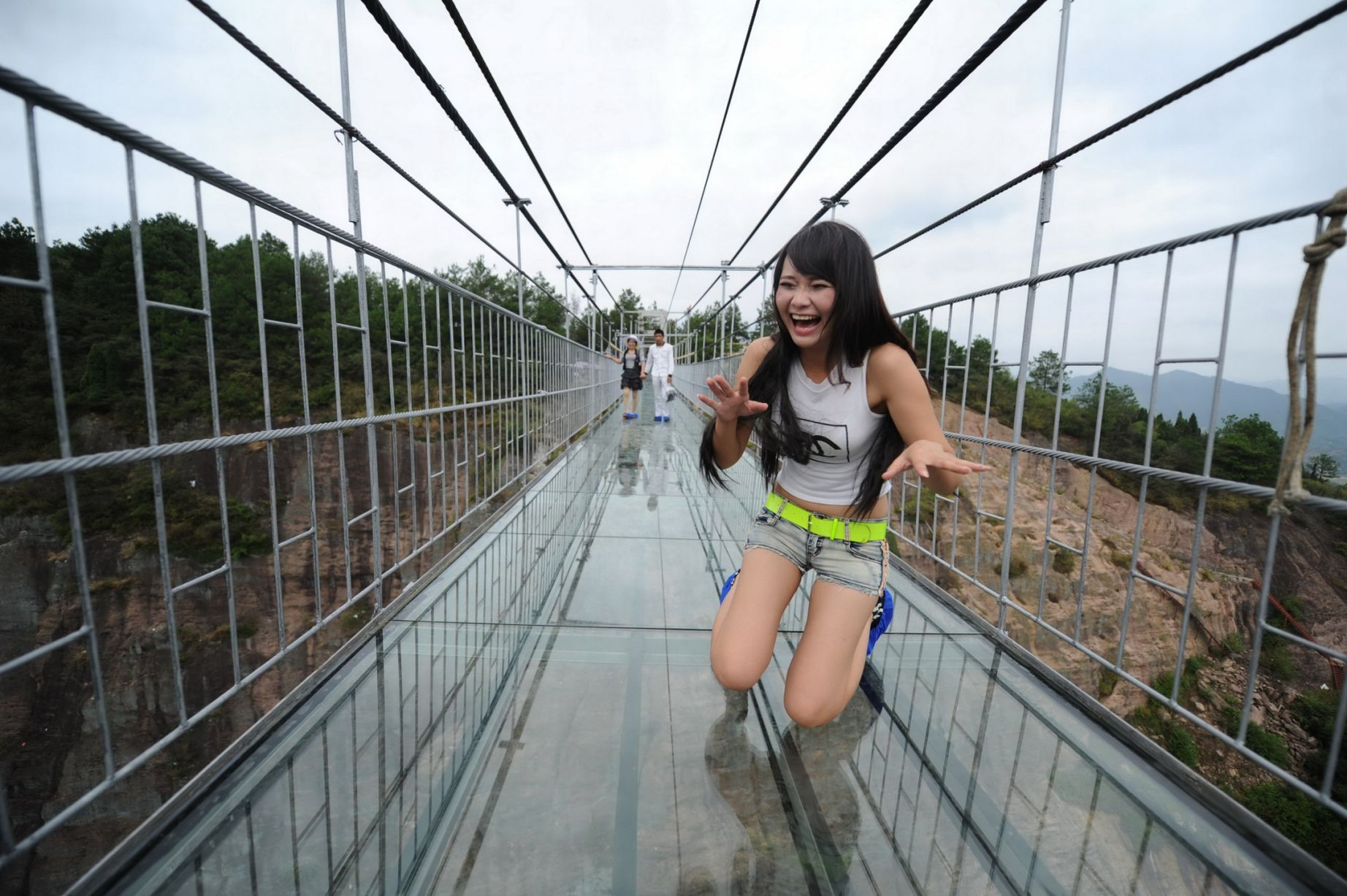 13 Pics Of A Glass Bridge That Strikes Fear In Tourists' Hearts 1