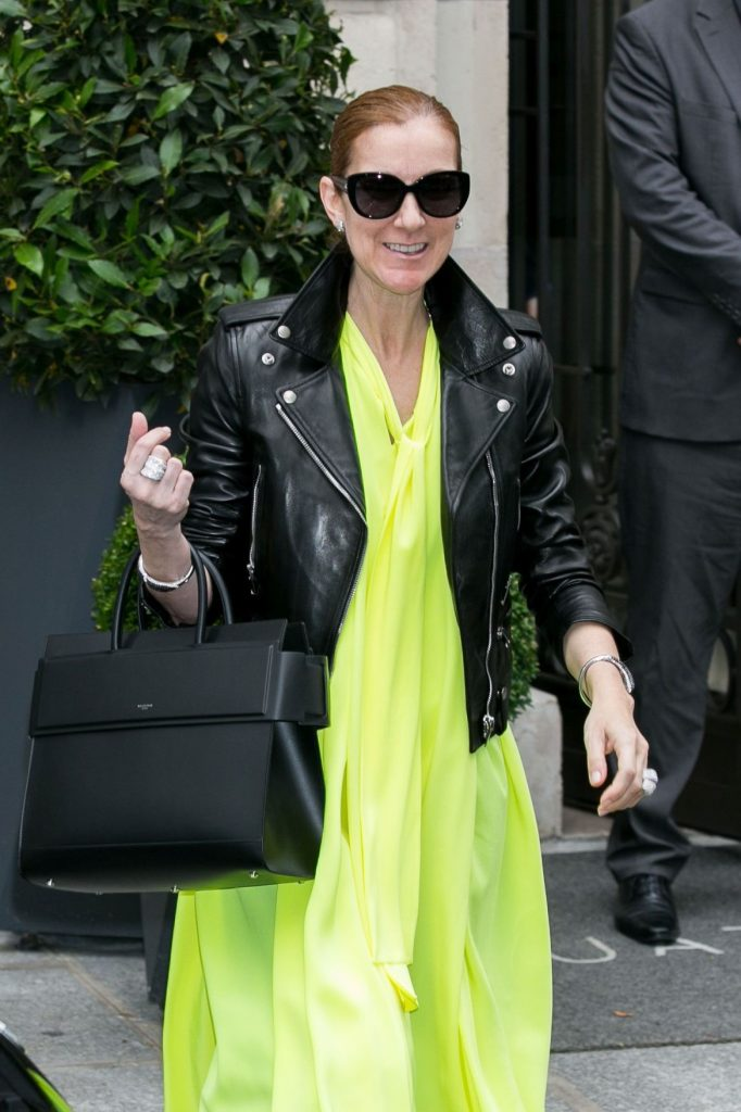 leather boots with a leather jacket and neon yellow tunic Celine Dion #2 | 10 Reasons Why Celine Dion Is Our New Style Icon | Her Beauty