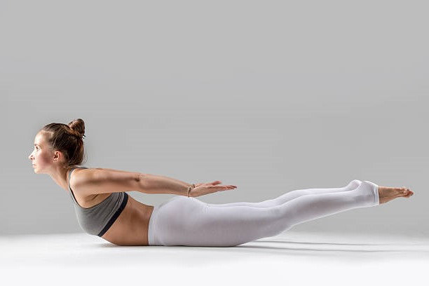Locust Pose   15 Morning Yoga Poses For Beginners   Her Beauty