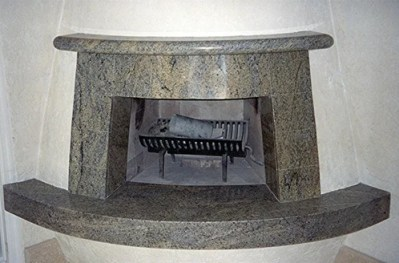 отделка камина гранитом