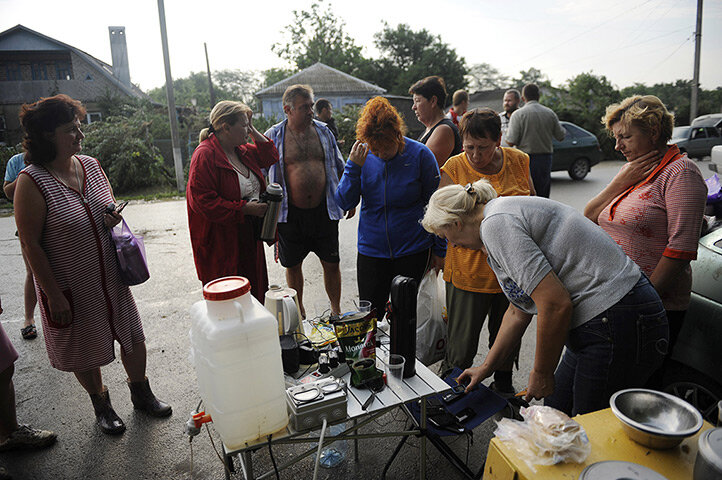 Victims of the flood talk together and charge their phones in Krymsk