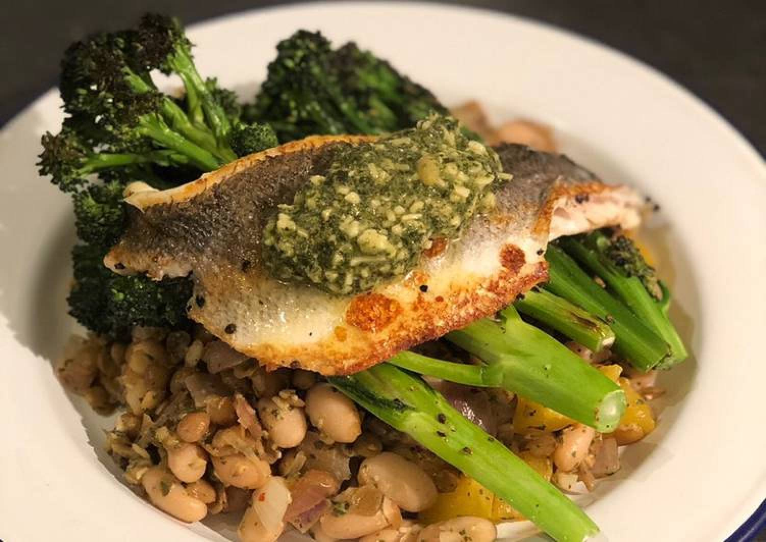 Pesto seabass with cannellini beans and purple sprouting broccoli