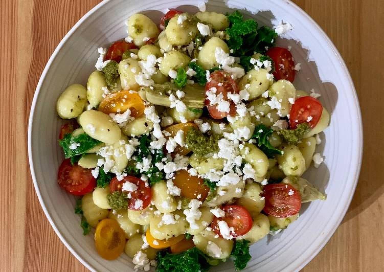 Gnocchi with pesto, artichoke, tomatoes and feta