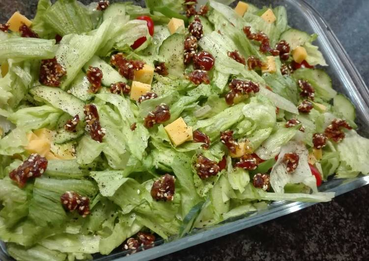 Simple salad topped with sesame Dates