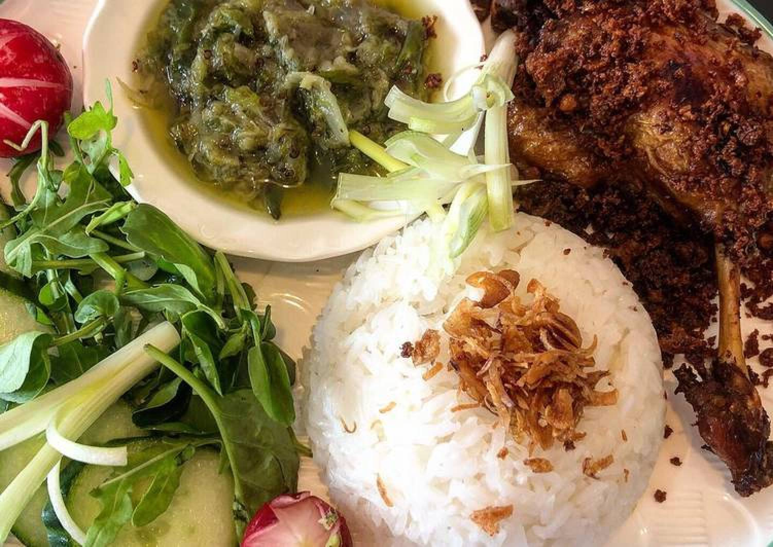 Indonesian deep fried duck with green chili sambal and crunchy bits