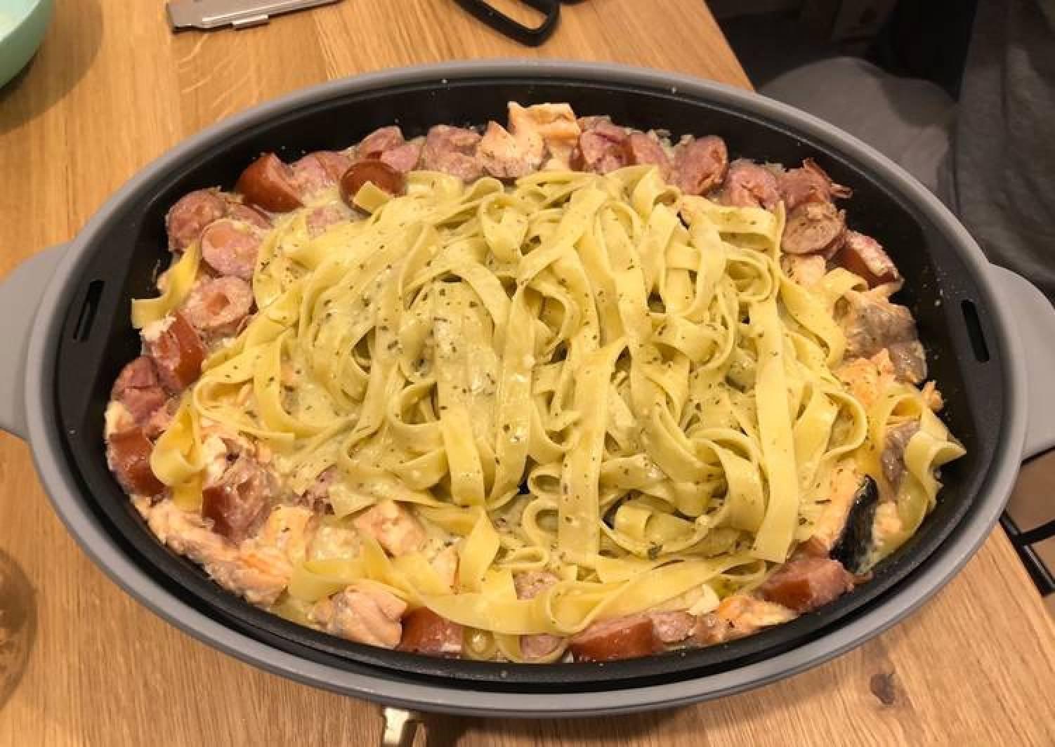 Fettucine with pesto, salmon and sausage