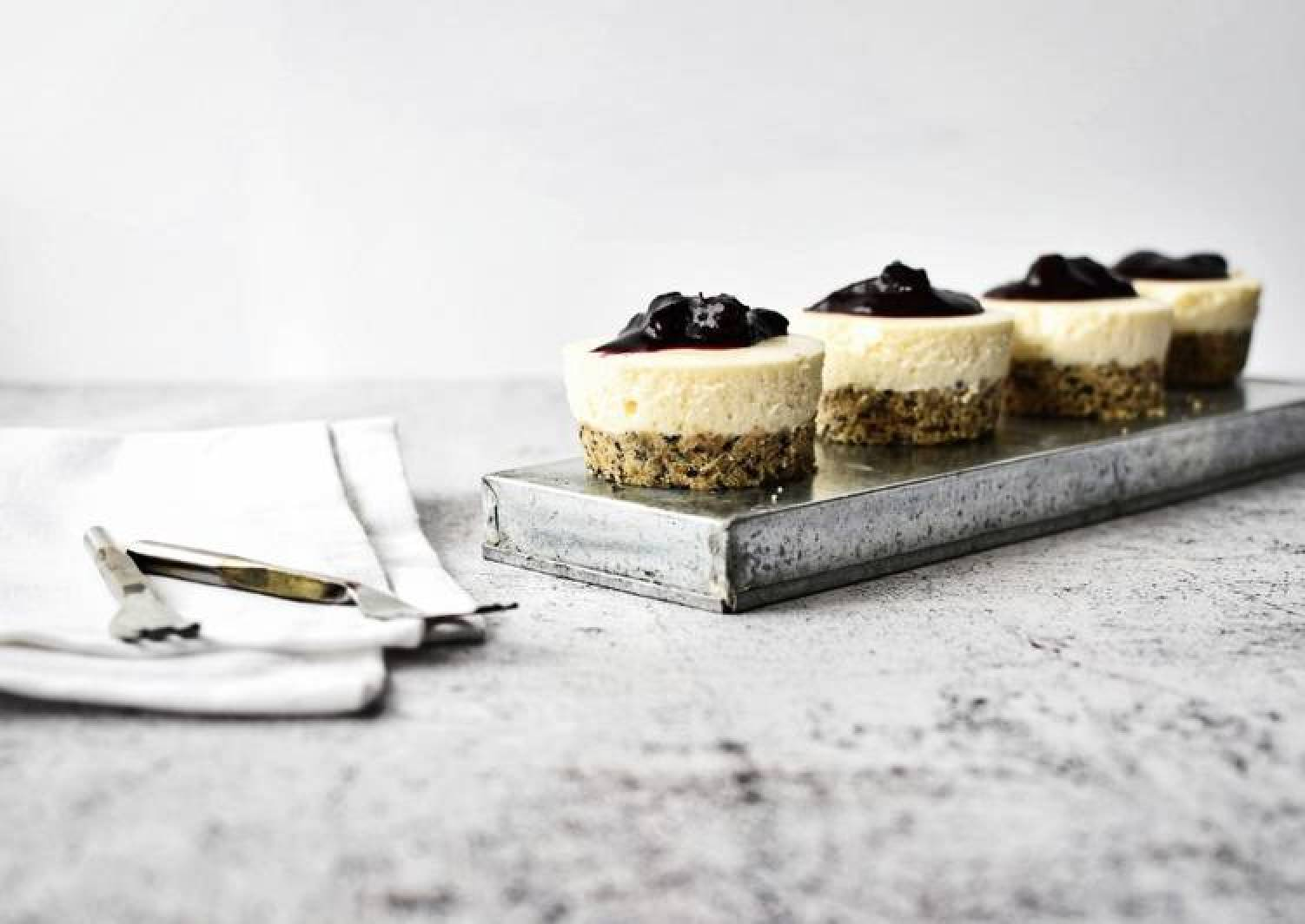 Mini No Bake Cheesecakes with Seeded Base and Blueberry Compote Topping