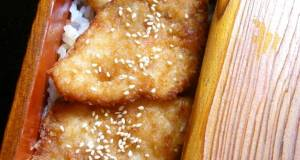 Chicken Breast Cutlets Over Rice Coated with Starch + Bread Crumbs