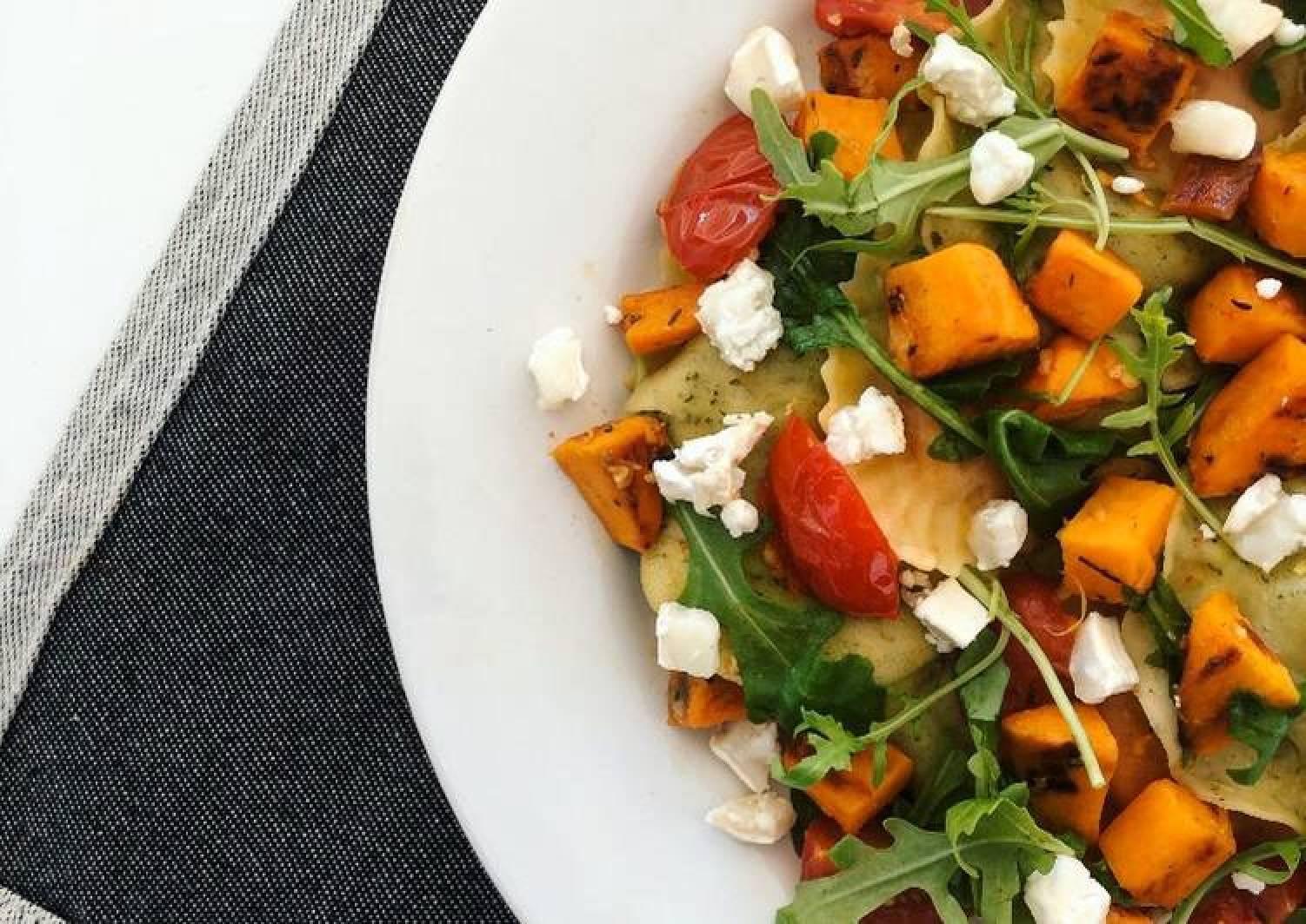 Sweet Potato Ravioli with Cherry Tomatoes, Goat Cheese and Arugula