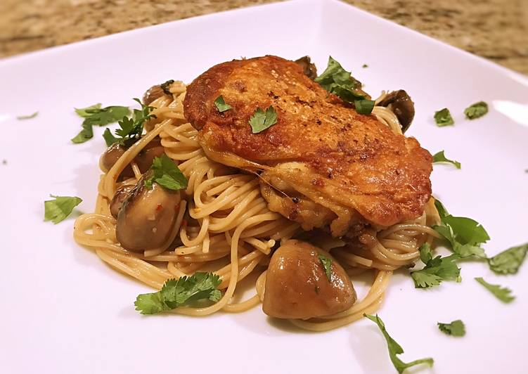 Crispy chicken thigh with angel hair, mushroom and garlic butter cilantro sauce