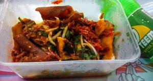 Roasted yam garnished with vegetable and ponmo sauce