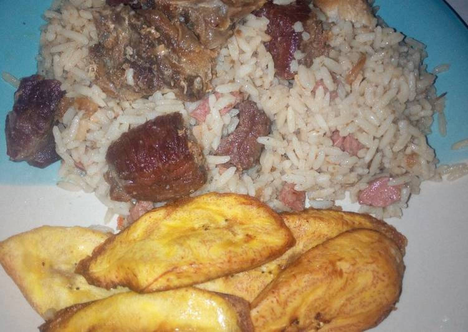 Coconut rice,assorted beef and chicken with plantain