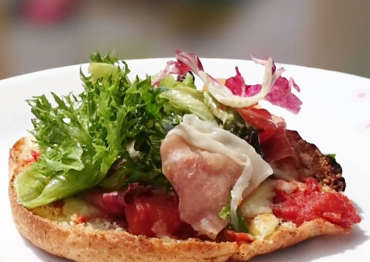 Proscuitto Pizza On Pita Bread Top Salad