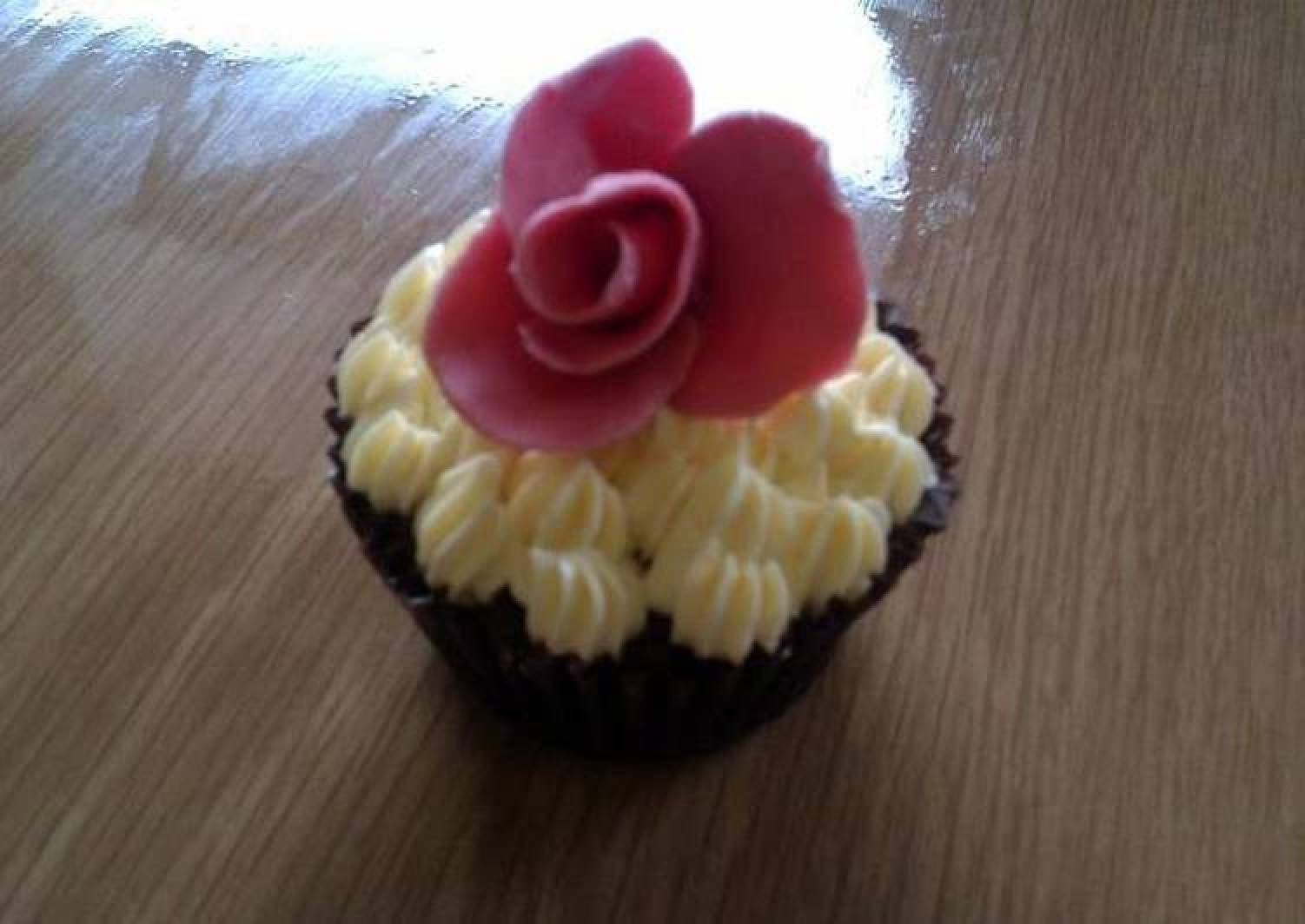 Indugant chocolate muffins with a vanilla bean butter cream topped with a homemade rose