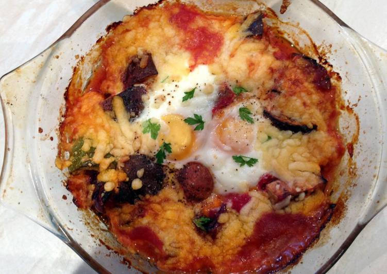 Baked eggs and aubergine in spicy sauce