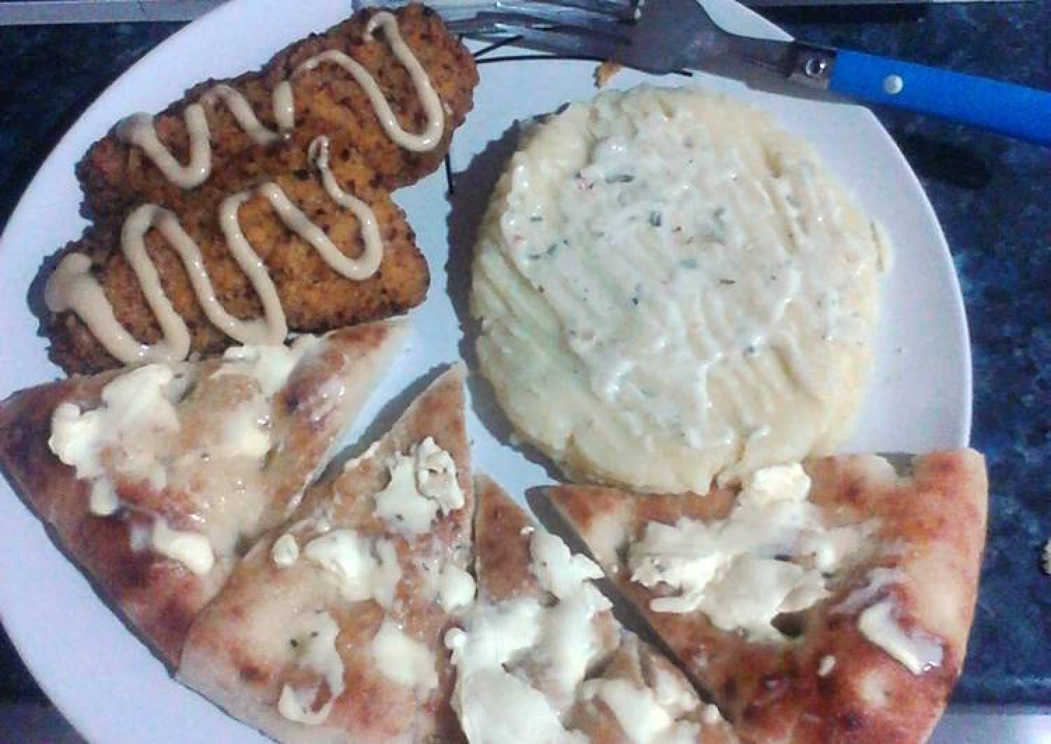 Delicious Dory Fillets with Creamy Mashed Potato and Garlic and Herb Turkish Bread.
